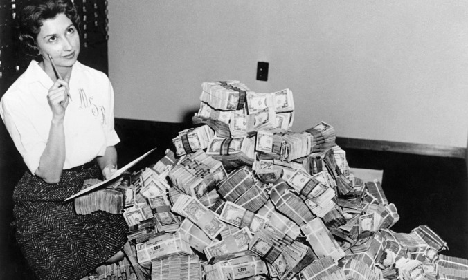 Woman with pile of money
